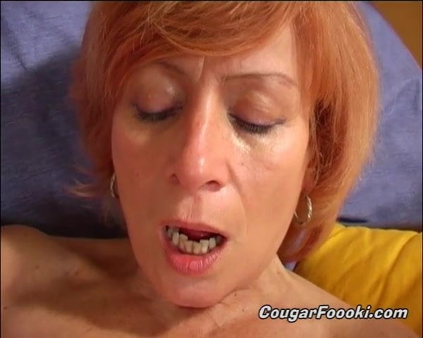 Horny GILF enjoys fingering herself and using favorite toy
