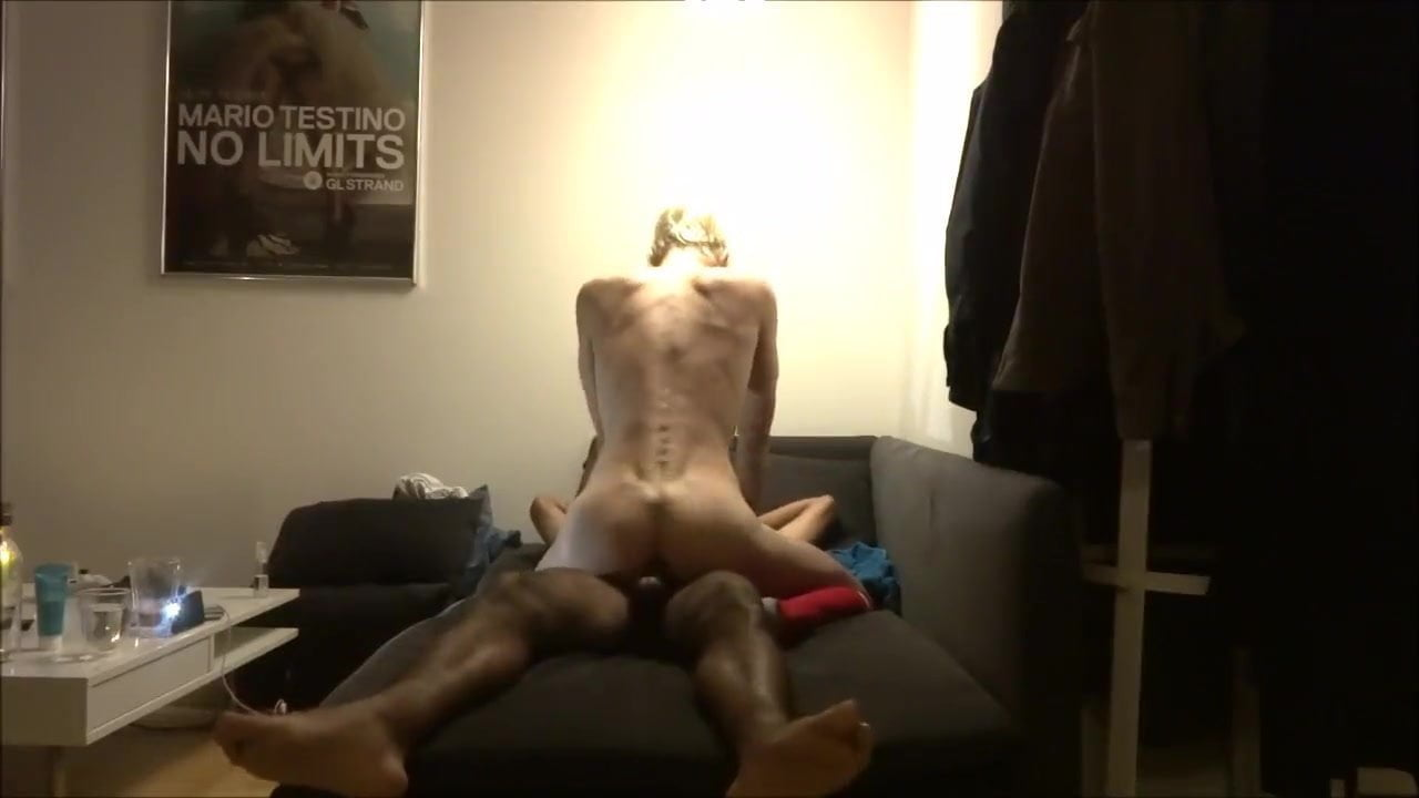 Longhaired blond femboy rides the black meat.