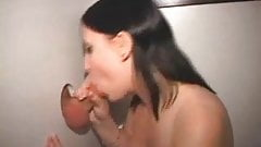 Busty girl sucking n stroking strangers cocks at gloryhole