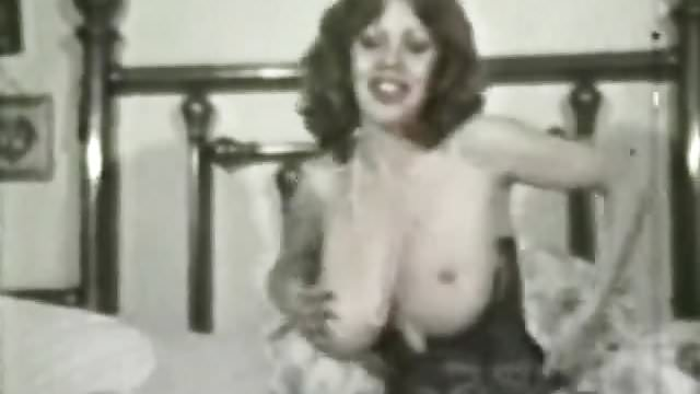 Preview 1 of Kitten Natividad Plays with Her Huge Tits (1970s Vintage)