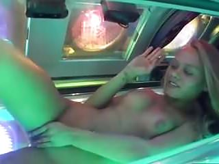 Hot girl fingering blonde bush and ass in tanning bed