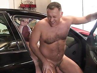 Daddies have sex at a garage