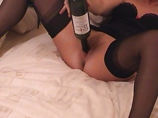 Girlfriend in Mules and FF Nylons ... and a wine bottle