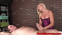 Rough femdom masseuse slapping and jerking