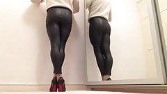 Black shiny PVC leggings .