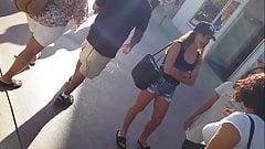 Candid voyeur hot teen in jean shorts shopping