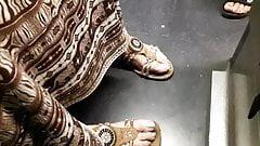 mature feet in train with longer toenails