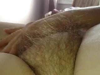 see how my wife enjoys stroking her own hairy pussy