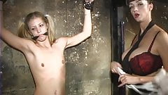 BDSM mistress teases blindfolded and gagged bondage blonde's tits