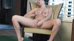 Busty Autumn masturbates her pussy on couch