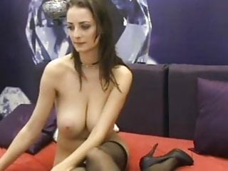 Shows her large boobs