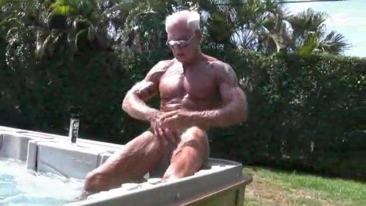 Older Man Masturbating exterior in Pool