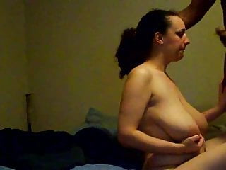 Huge Busty sucking a black cock