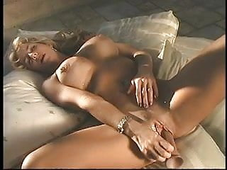 Hot blonde with amazing tits fingers her tight pink pussy