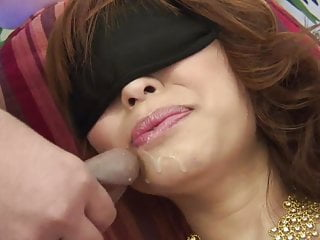 Brunette with her eyes covered gets her clit teased with toys