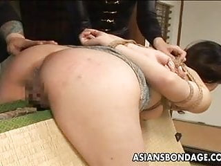 Preview 3 of Tied up Asian babe gets spanked and dildo fucked