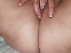 Wife playing with her mature pussy