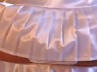 Jesse teases in white satin skirt and panties