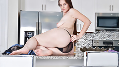 USA milf Christina Sapphire finger fucks herself in kitchen