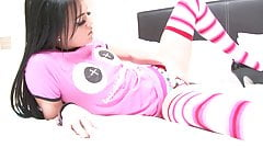 Brunette in sexy socks opens her legs wide to show her cunt