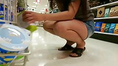 Squatting college teen in short shorts