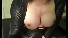 busty tgirl plays with a big realistic dildo