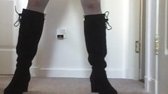 Walking in knee high boots and flashing