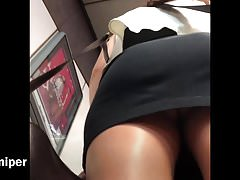 Upskirt - sexy G-string cover by tight skirt at mrt