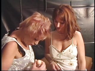Lesbians dildo and fuck each other with strapon