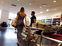 Candid voyeur MILF in tight striped dress shopping
