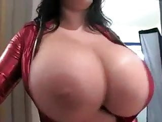 British brunette exposing her huge natural tits