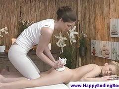 Oiledup lesbian masseuse rubs pussy on ass