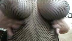 Fishnet bodystocking tease