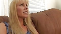 MILF Nicole Moore sucks on a long thick cock