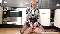 Blonde granny fucks young boy in the kitchen
