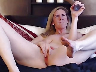 Petite young kitty with small natural boobs rides her dildo