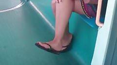 Candid Feet in Flip Flops Legs Face on Train