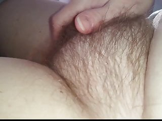 my wife gently caresing her soft hairy pussy mound,
