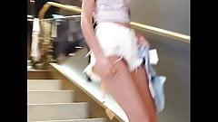 Candid voyeur hot tight teen showing cheeks shopping
