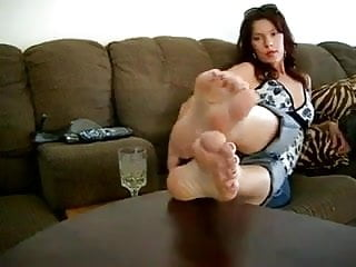 Beautiful lady showing off her hot soles, on a table.
