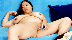 BBW Undresses and Pleases Herself with a Vibrator