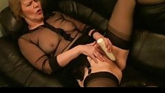 Masturbating mature in stockings