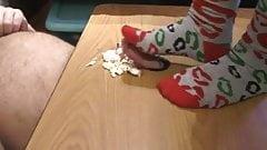 sockjob on a christmas cake in chiristmas socks