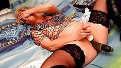 Lisa playing with cucumber in open pussy