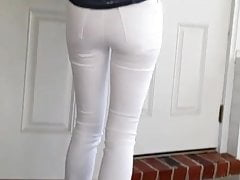 Candid hot neighbor in tight white jeans