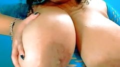 Huge breasts on Latino Goddess as she pinches nipples