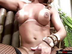 Blonde t-babe in fishnets lathers up her breasts and big ass
