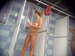 Voyeur beauty with a smooth body in the womens shower room Thumbnail