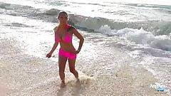 Big tits in a bikini at the beach