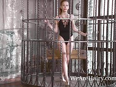 Mimi Lea escapes her cage to strip naked for you